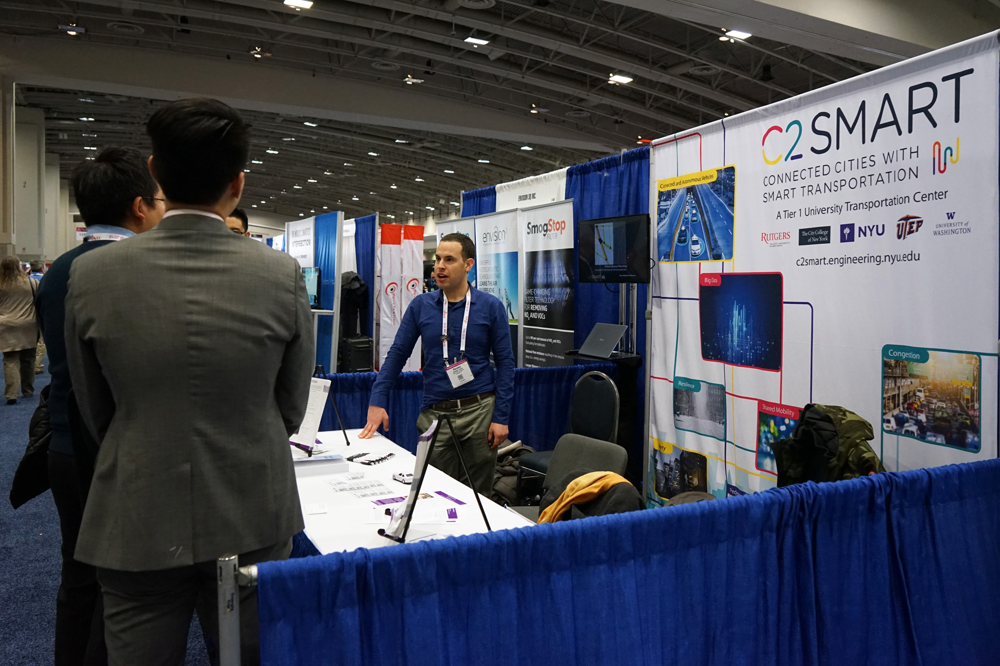 Graduate student Reuben Juster greets visitors at C2SMART's TRB booth.