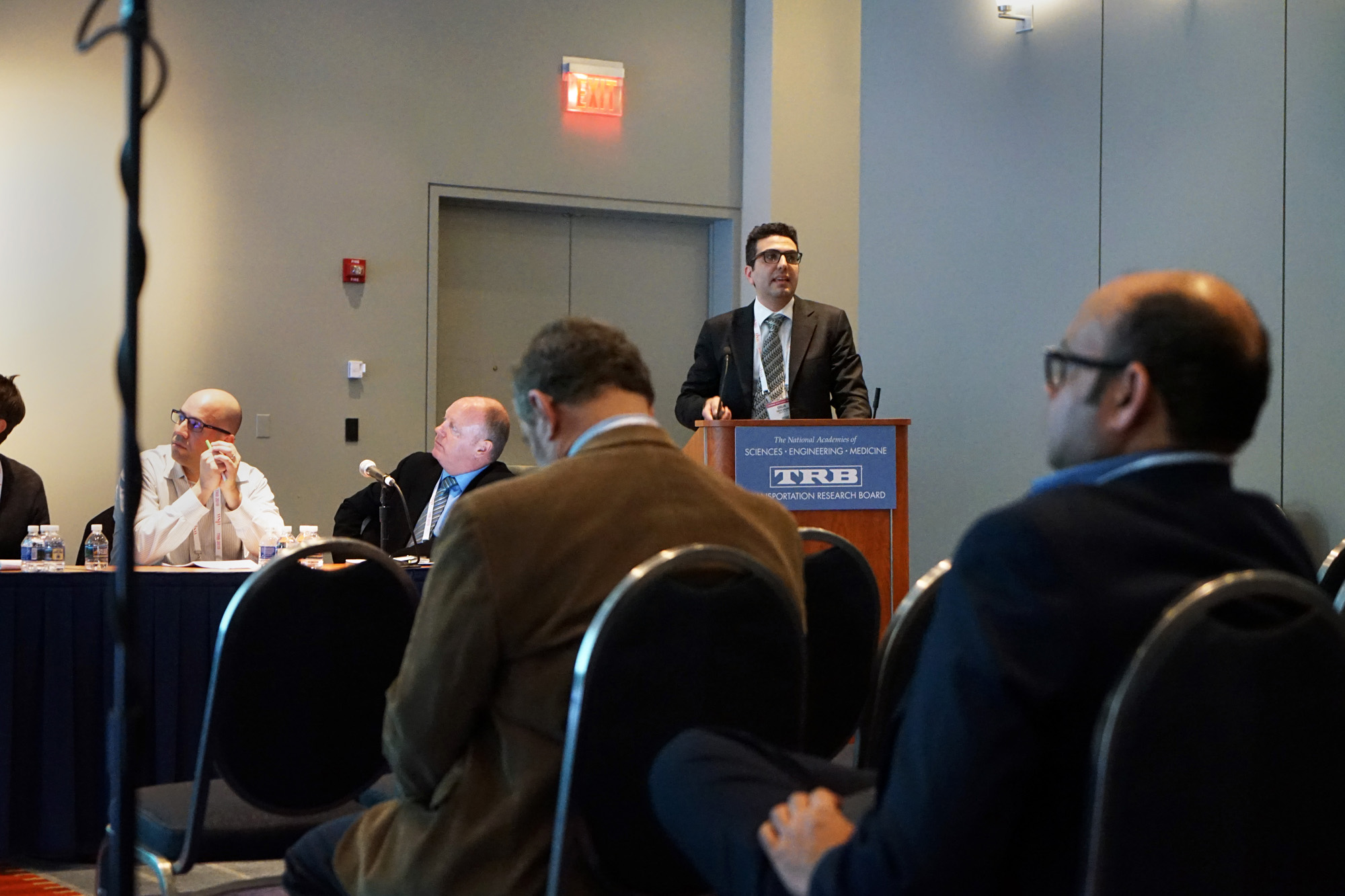 Postdoctoral researcher Onur Kalan presents during a lectern session at TRB.
