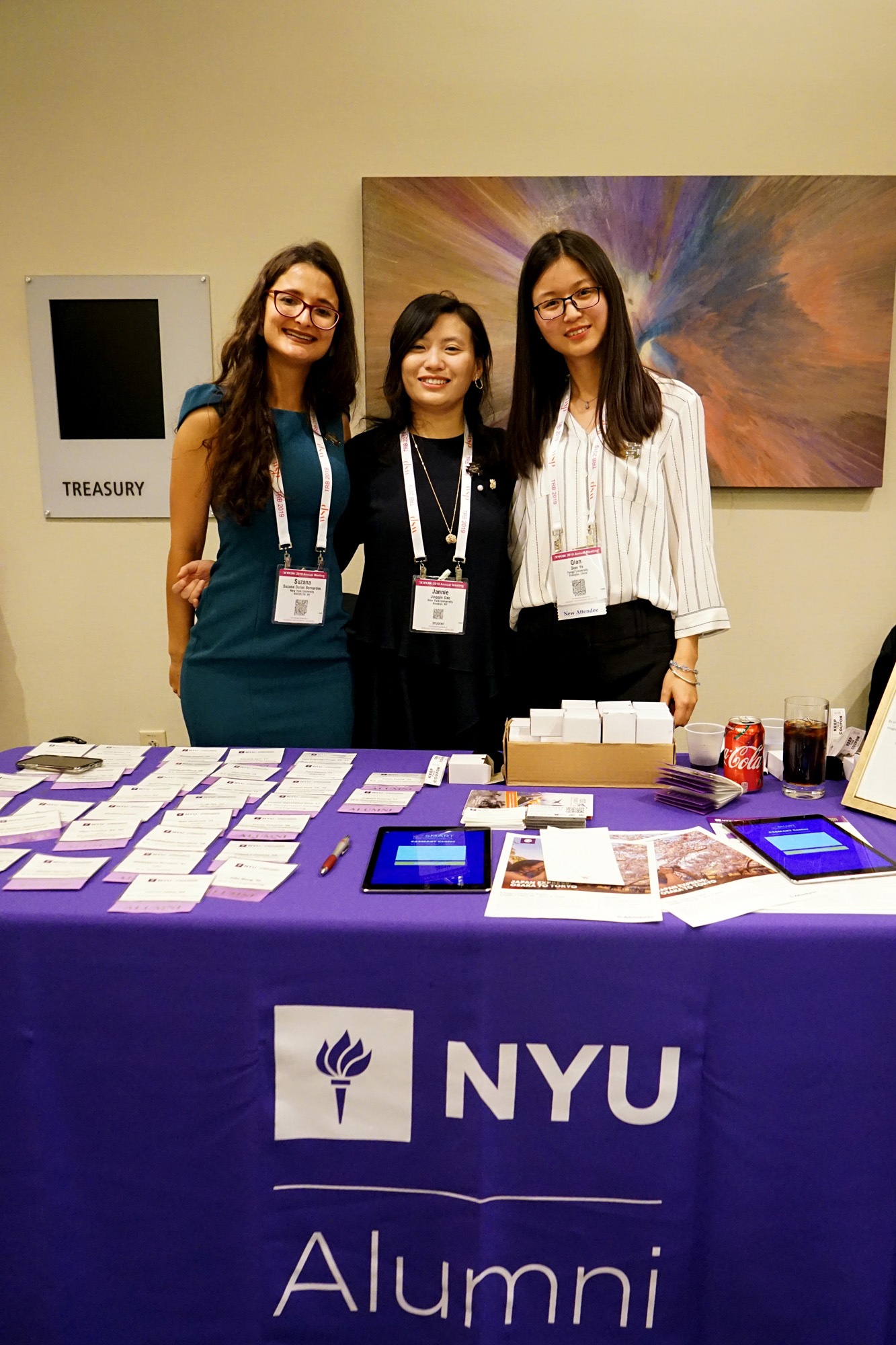 Students Suzana Duran-Bernardes, Jingqin Gao and Qian Ye pose for a picture outside the NYU/C2SMART reception at TRB.